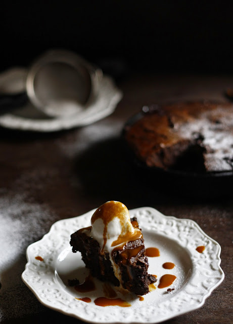 Brownies baked in the skillet with caramel sauce swirled in