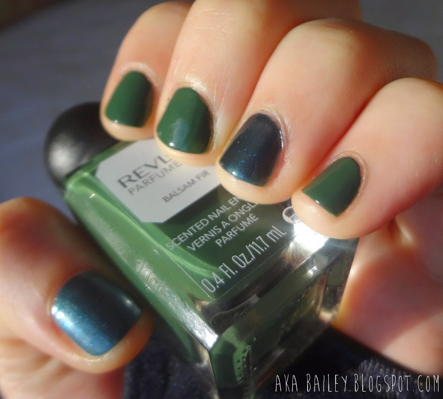 Revlon Parfumerie Balsam Fir with navy teal accent nails