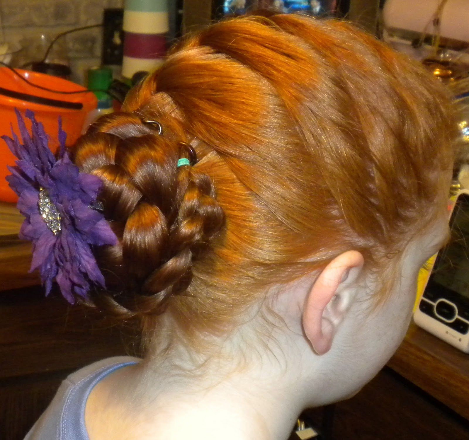 Emily and isabella bella has double french braids with a zig zag part and ribbons emily has a bunned french braid with a flower crowning the bun ccuart Images