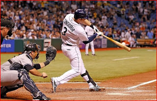 perfect picture of Evan Longoria's home run just as it leaves the bat