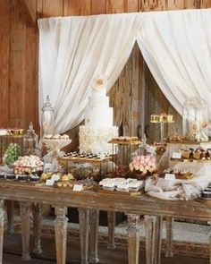 The backdrop and the custom cake stand are great accent pieces on this buffet