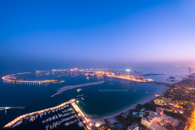 Photo of palm island in Dubai at night as seen from one of the skyscrapers