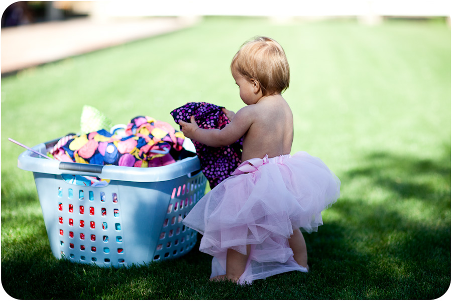 Baby Searching for New Outfit in Basket Wardrobe