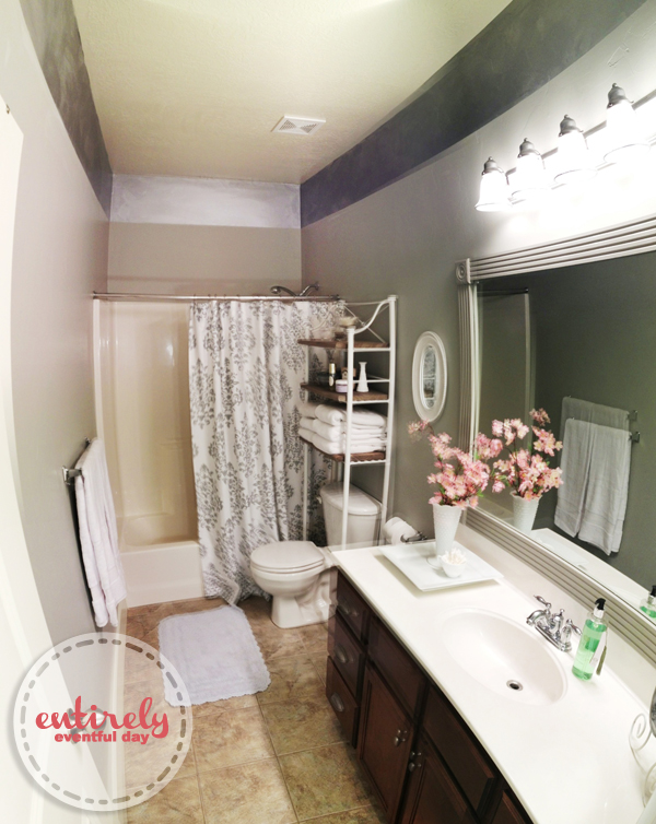 Beautiful DIY bathroom makeover.  I love the gray. She painted a silver stripe at the top of the wall and it looks amazing.  I wouldn't have thought of that.  Must pin! entirelyeventfulday.com #DIY #bathroom