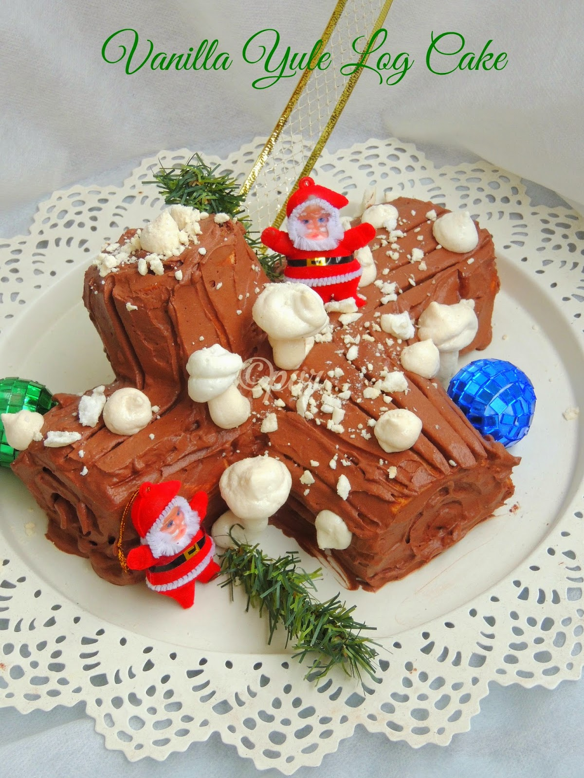 Vanilla Yule Log Cake with chocolate whipped cream
