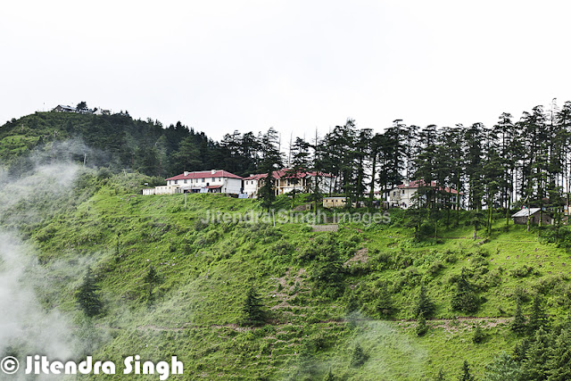 Chakrata is a beautiful & calm hill station in Uttrakhand state of India. Jitendra love such peaceful places to explore and hill stations in this category ranks on top for him. Let's check out this PHOTO JOURNEY through Jitendra's Travelling-Camera.Chakrata is getting more popular as a hill station and people love spending some quality time around these beautiful/fresh hills. Chakrata is basically a cantonment area in Dehradoon district of Uttranchal which quite clean and peaceful. Chakrata town of Uttrakhand can be reached from Dehradun via Mussoorie or Vikasnagar. Both routes pass through beautiful mountainous road. Travelling in the monsoon can be more adventurous as the area sees frequent land-slides, which usually block the roads for longer period of time or at least significantly impact the travel plans.Yamuna valley has amazing panoramic view of the surroundings from the hillock. Chakrata is basically developed by the British rulers and was a summer retreat for the high executives of English East India Company, like other places in Northern India - Shimla, Dalhousie, Masoorie etc. Presently Chakrata encloses military cantonment and the access is restricted here for civilian travelers.The area has an lot of conifers, red rhododendrons and oaks. One of the key attractions near Chakrata is the waterfall named 'Tiger Fall'.Overall local folks are quite helpful and simple. Talking to anyone on the streets around Chakrata is a wonderful experience, where people welcome with broad smiles on their faces. All this makes the travel experience more enjoyable with happy faces all around, who are quite welcoming and helping in natureChakrata is an access-restricted military cantonment and foreigners face severe restrictions in visiting while around this region. It is the permanent garrison of the secretive and elite Special Frontier Force, also known as Establishment 2-2, the only ethnic Tibetan unit of the Indian Army, which was raised after the Indo-China War of 1962.A secluded nearby, leafy hamlet of Deoban offers a panoramic view of the Himalayas stretching from Kinnaur in Himachal to Garhwal and Kumaon. It's almost like Kasauli in Himachal, which has again army regions with very well mmaintained buildings. Chakrata has lusting greeneries with dense forests all around and it's famed as a tourist destination where come to enjoy the natural beauty with calmness and awesome freshness all around. Cool but pleasant ambiance makes the stay in Chakrata more enjoyable. There are various trekking and adventurous activities around Chakrata.Kharamba peak is the highest mount in Chakrata with an altitude of around ten thousand feets. Nature lovers, Trekkers, bird watchers and wild life enthusiasts can spend days together here in the lap of Chakrata exploiting the nature's hidden treasures and beauties, which sounds most exciting to me and love coming here again n again.This Photo Journey has few shots from Chakarata Market, which is very well equipped with almost every daily usage stuff. Due to cantonement, there are multiple shots. There are some shops, which offer hand-made woolens and can be a good souvenir from hills of Chakarata, Uttrakhand, INDIAChakrata area also has a number of temples including ones at Hanol, Mahasu Devta Temple dedicated to Lord Mahasu , Radina, Thaina, Indroli, Lakhwar, and Lakhamandal, on the banks of river Yamuna, known for its ancient Shiva Temple, which traces its existence to the legends of Mahabharata, the village also has several natural caves.This photograph gives an amazing view of foggy morning at Chakarata. This gives a sense of awesome weather on hills of Chakarata. While in hills, this fog excites you more as compared to plains. Also it adds a lot of value to your travel in hills, which real feel of mountains.The forests & hills around Chakrata has an amazing flora and fauna, along with innocent kids with always smiling faces and ready to get clicked. These hills are natural habitat of many wild life species including panther, spotted dear and wild fowls.