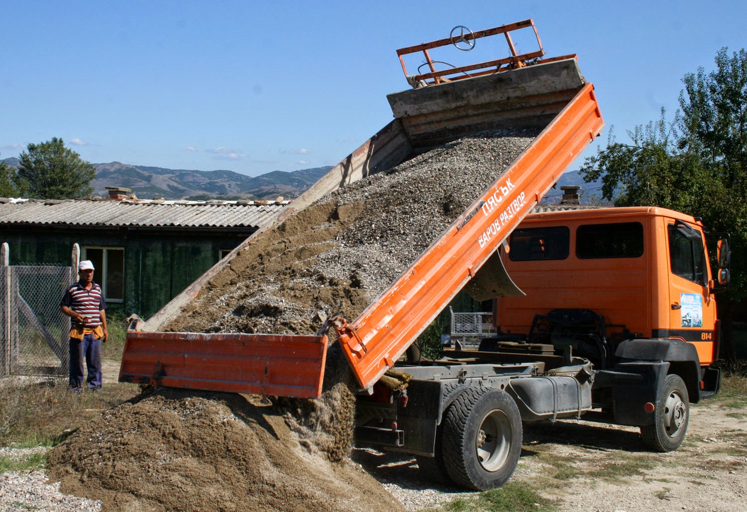 A delivery of gravel and sand for cement making