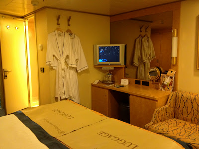 Interior stateroom vanity area with TV and mirror