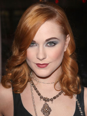 A sultry red hue adds a glamorous touch to Evan Rachel Wood's soft, rolling ribbon curls.