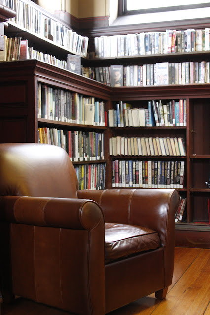 leather chair and bookshelves at library