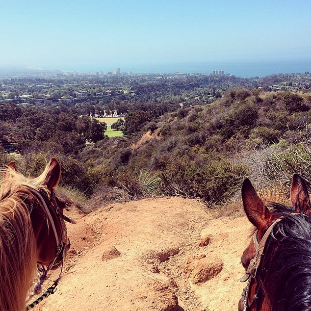Couples horseback riding trip in Pacific Palisades, California