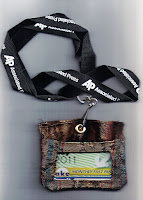 Bus rider's pass in hand-made brocade ID pouch on laniard