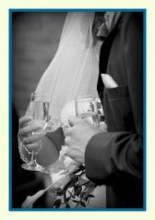 A couple shares a drink at their wedding.