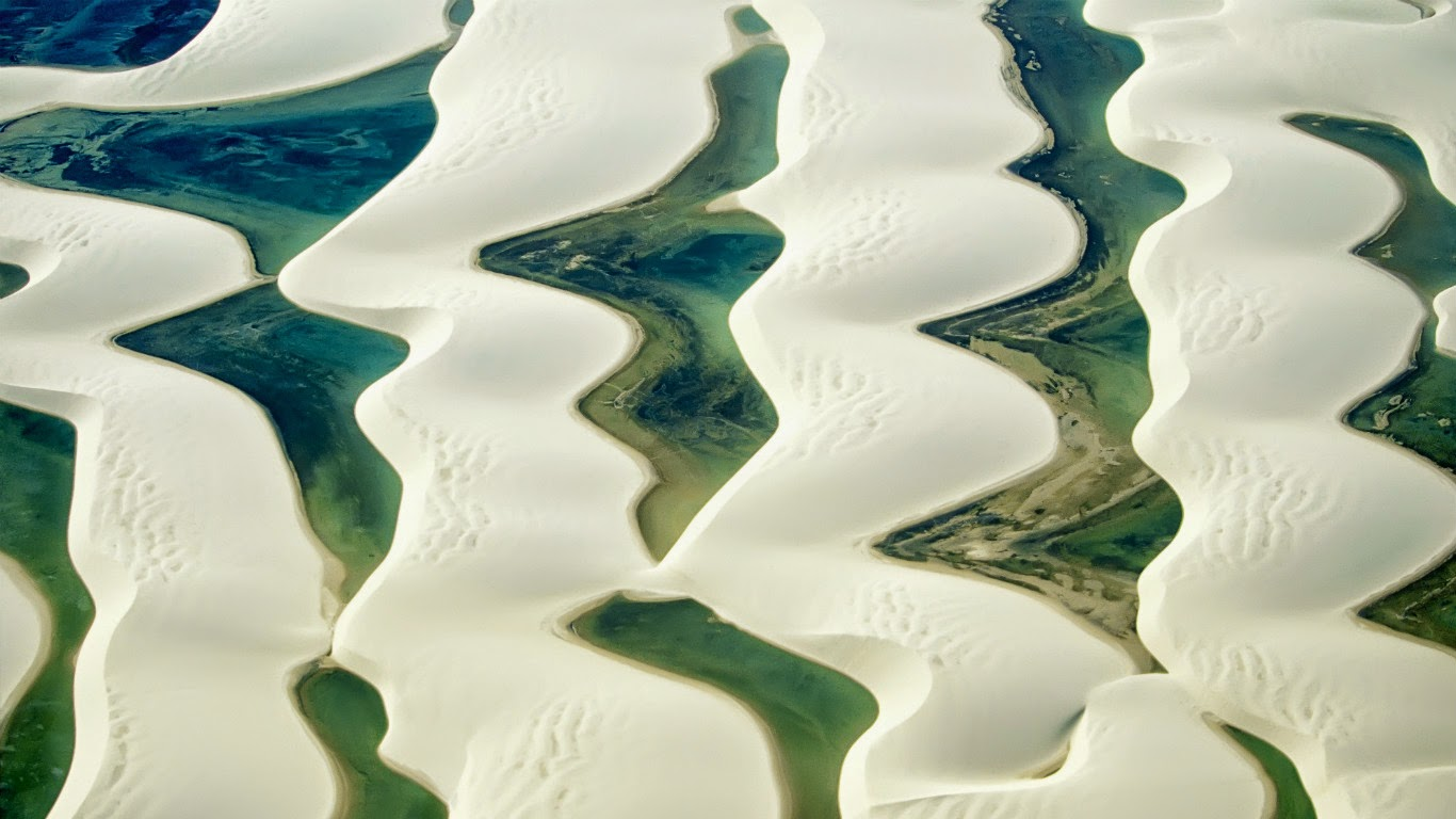 Sandy dunes and natural pools, Lençóis Maranhenses National Park, Maranhão, Brazil (© Marco Simoni/Getty Images) 161