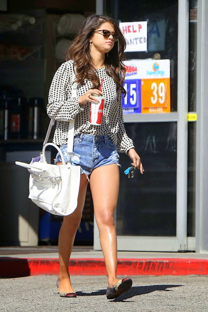 Selena Gomez shows off toned legs in denim shorts out and about in LA