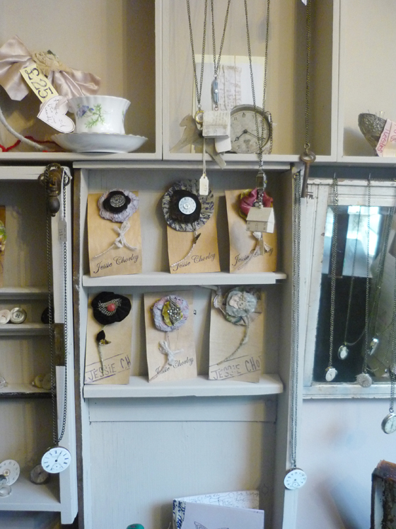 shop display showing brooches