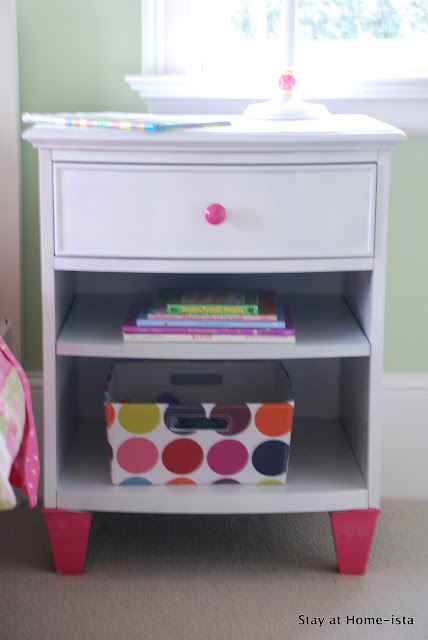 white nightstand with pink feet