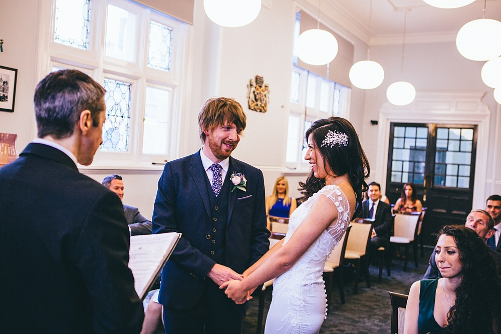 cute photo of couple just married and about to kiss very smiley