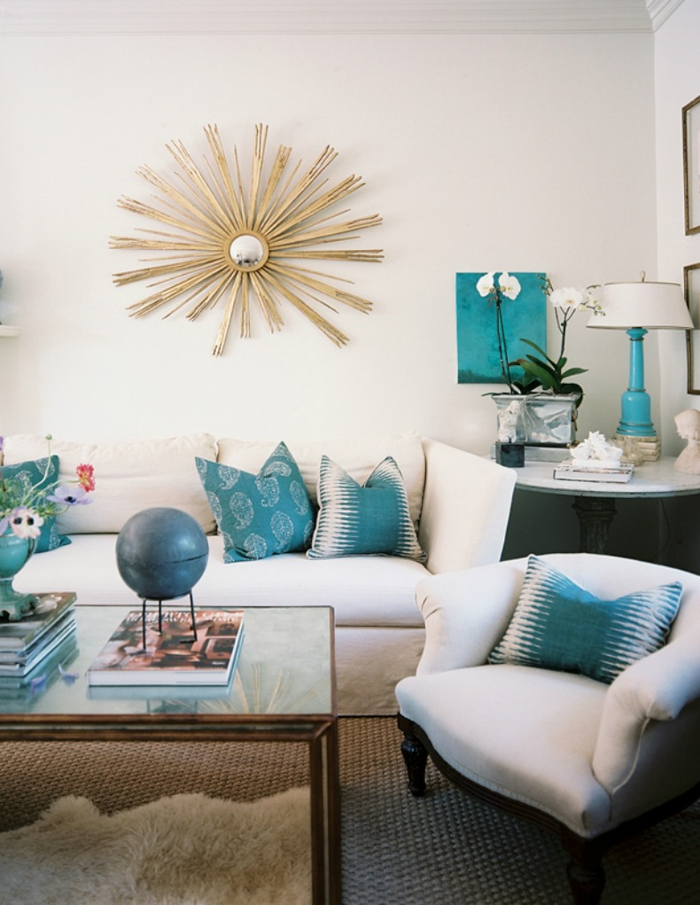 aqua and white coastal room with white sofa and chairs