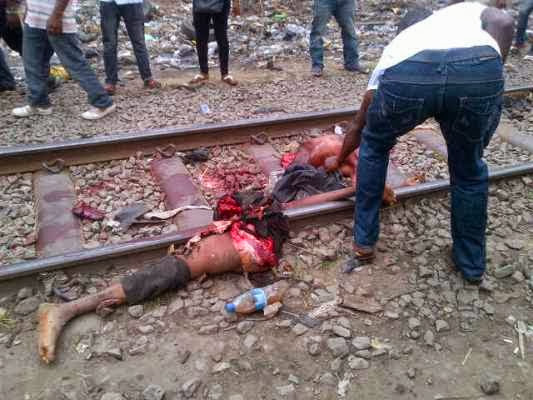 Railway track with his friends when a train coming from agege crouched