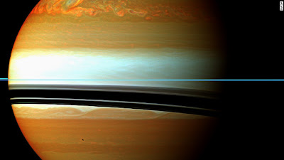 These red, orange and green clouds on Saturn represent the tail end of a 2010/11 massive storm