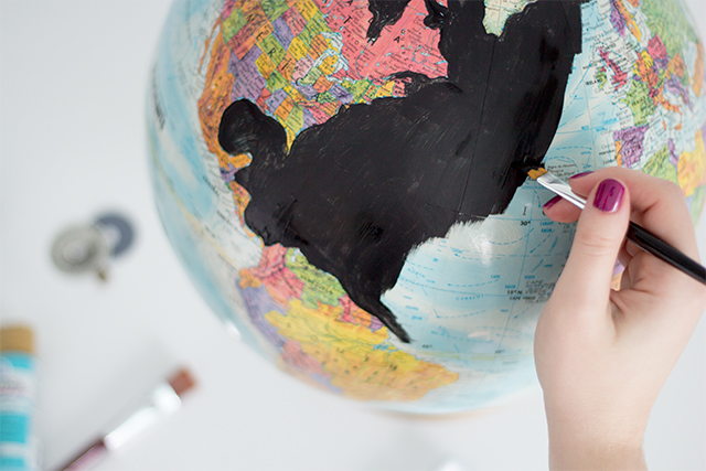 Painting the water on a DIY anthropologie inspired globe.