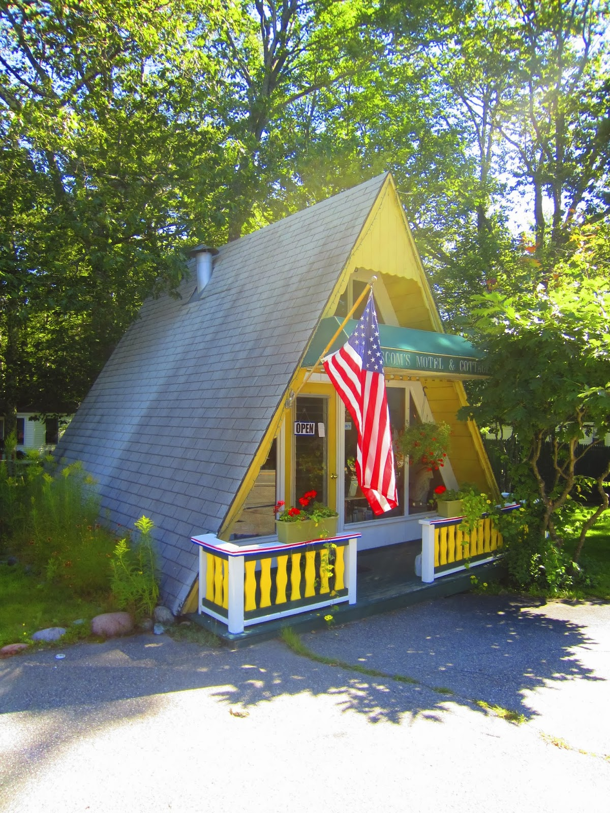 A tiny yellow a frame cabin cottage in maine for Maine home plans