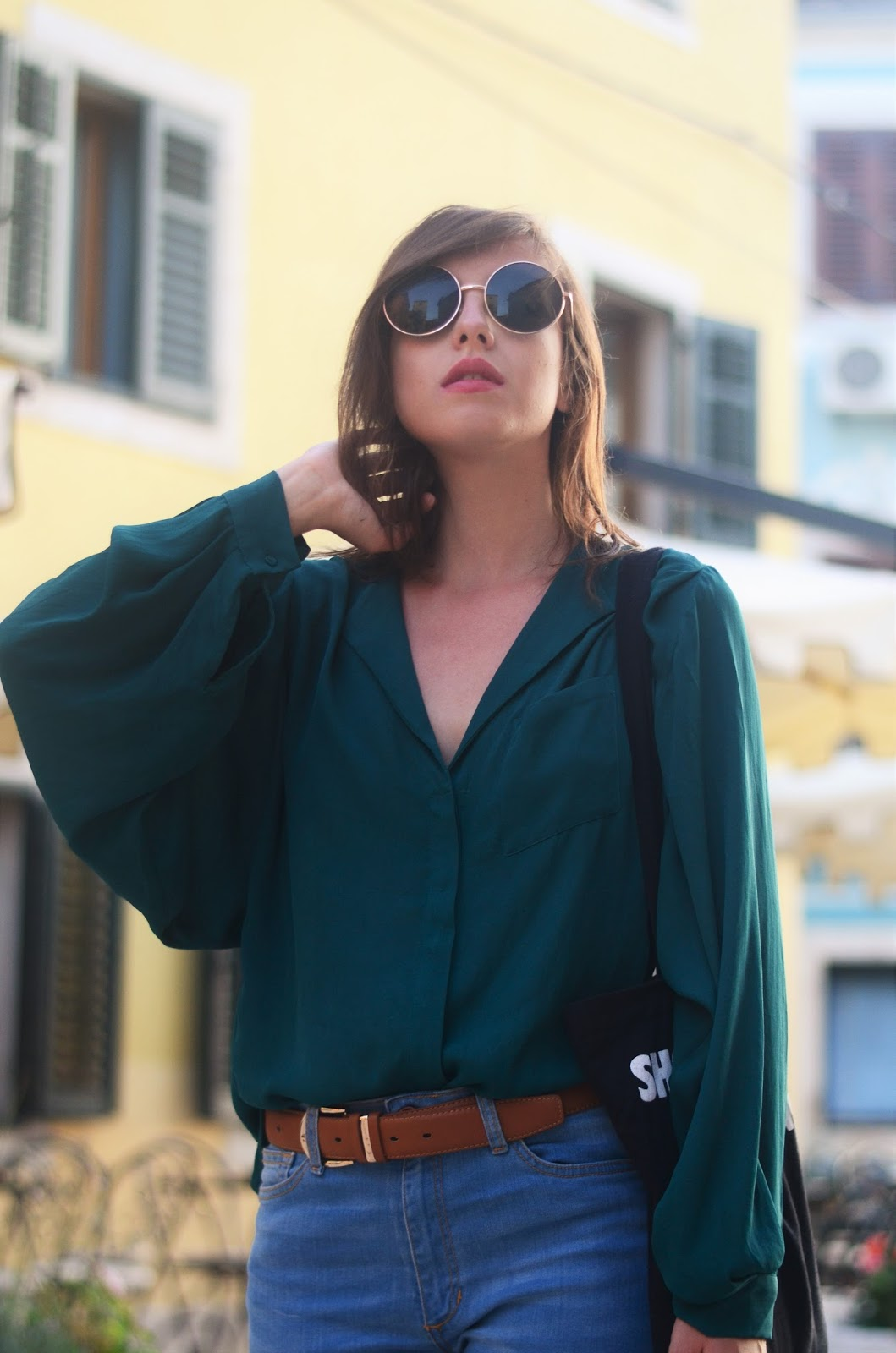 retro outfit with flare pants loose shirt and camel belt