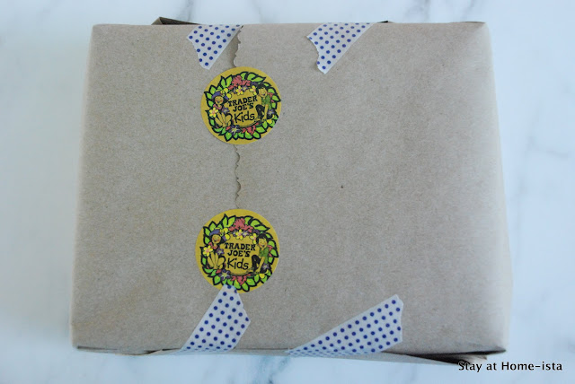 craft paper as wrapping paper, washi tape, stickers and stamps. Such an easy way to wrap a birthday gift!