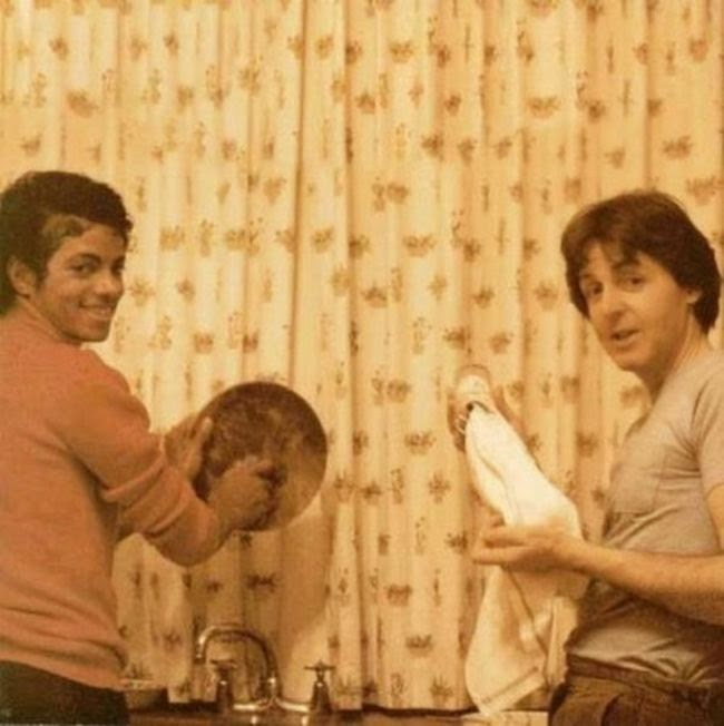 Michael Jackson and Paul McCartney finding time to finish cleaning the dishes.