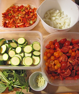 Containers of Chopped Onion, Garlic, Tomatoes, Zucchini, with Basil