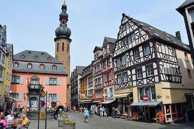 Medieval half-timbered architecture of the village square in Cochem, Germany.