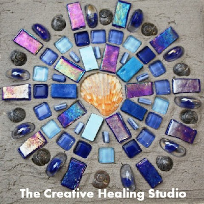 healing blue mosaic mandala with shells