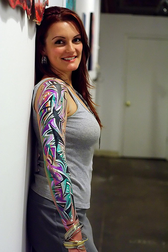 half sleeve tattoos pictures. half sleeve tattoo girl.