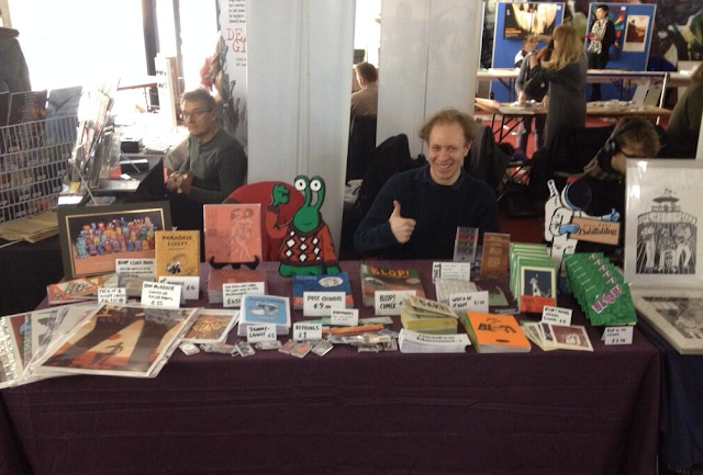 Photo of Alex Hahn and his stall at Thought Bubble convention from November 2013