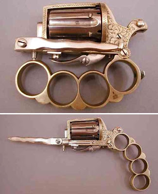 weird weapon brass knuckles knife gun