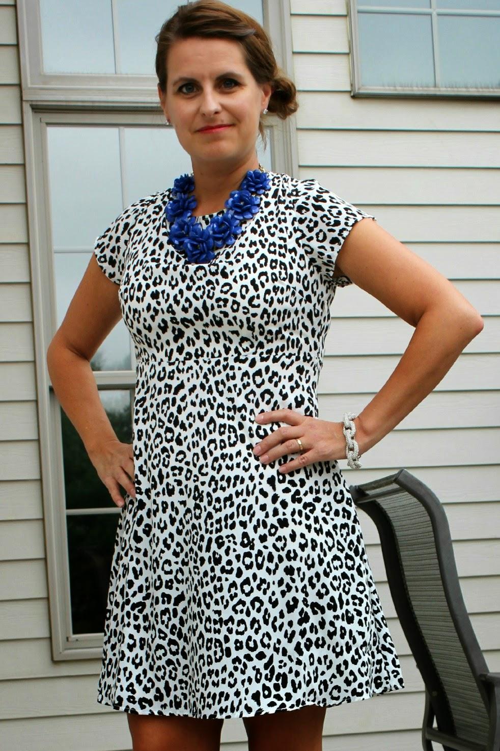 Old Navy Snow leopard dress, edgy black heels, blue florette necklace