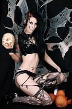 Deathrock beauty Razor Candi shows her porcelain flesh for Halloween