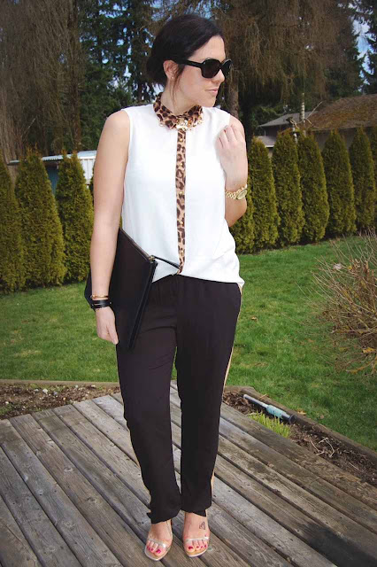 Track pants, a leopard detailed blouse, Coach clutch and Stuart Weitzman gold heels.