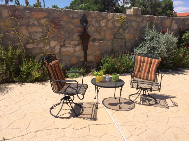 These chairs and small table are in the pool area. You may notice that we  keep the cushions on the back of the chairs instead of the seats because  the ...