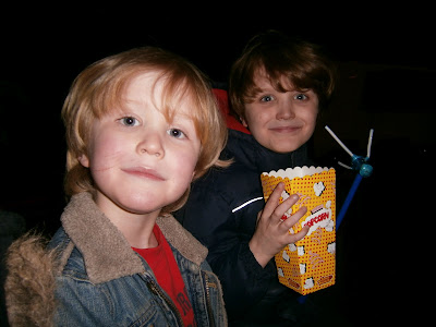 pop corn at the circus boys havign a fun time