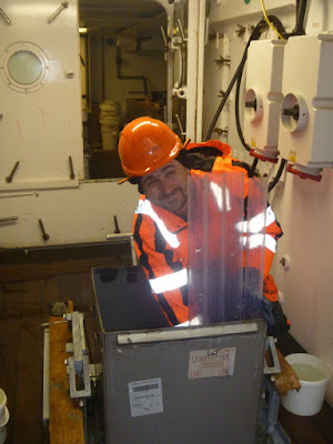 Rowan collecting samples from the seafloor sediment