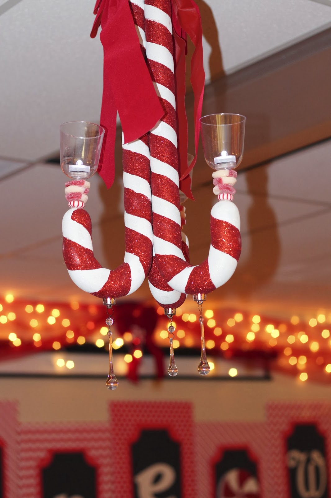 Large candy cane ornaments - I Took Three Large Candy Cane Ornaments Turned Them Upside Down And Glued Them Together With My Glue Gun The Tea Light Holders Are Plastic Wine Glasses