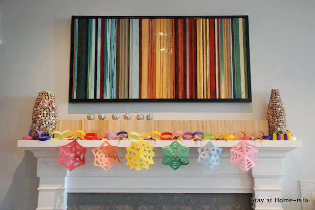 Paper snowflakes on a rainbow mantle