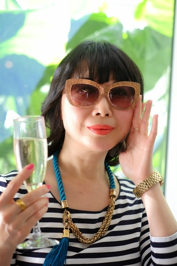 Vivienne trying the large golden Kate Spade sunglasses.
