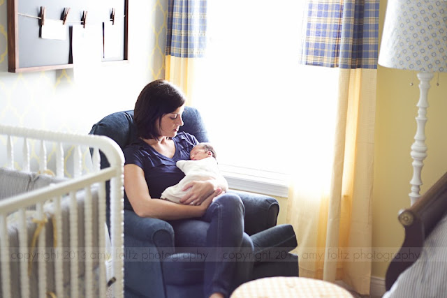 photo of mommy and newborn in nursery