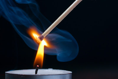 A photograph of a match-stick as it catches fire