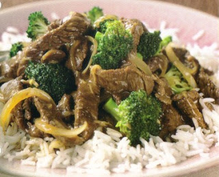Picture of Beef and Broccoli Stir-Fry with white rice on a white plate.