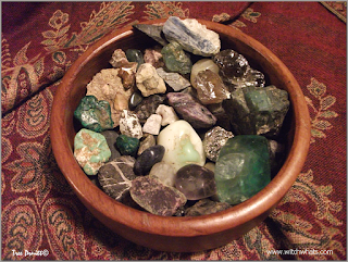 Witch Whats cleansed stones in a wood bowl.