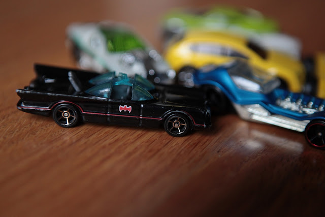 The Batmobile and four other Matchbox cars in an unfortunate fender bender.